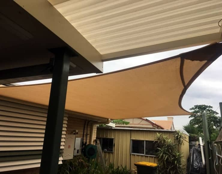 Brisbane shade sails installation at Sunnybank-Patio entertaining area with sail-track in Abshade Sandstone. Material and galvanised steel posts powder-coated in pale eucalypts.