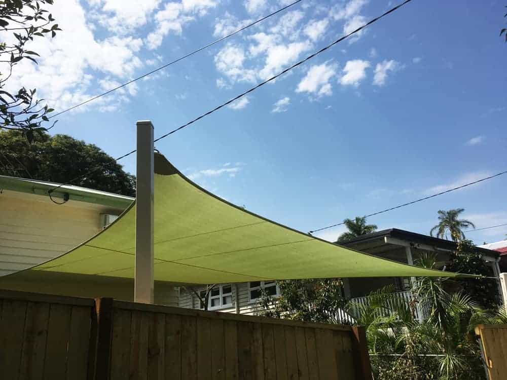 Indooroopilly, Brisbane - Shade sail installation of 1 x 4 point shade sail attached to a Queenslander home with sail track and powder-coated posts. Installed by Superior Shade Sails.