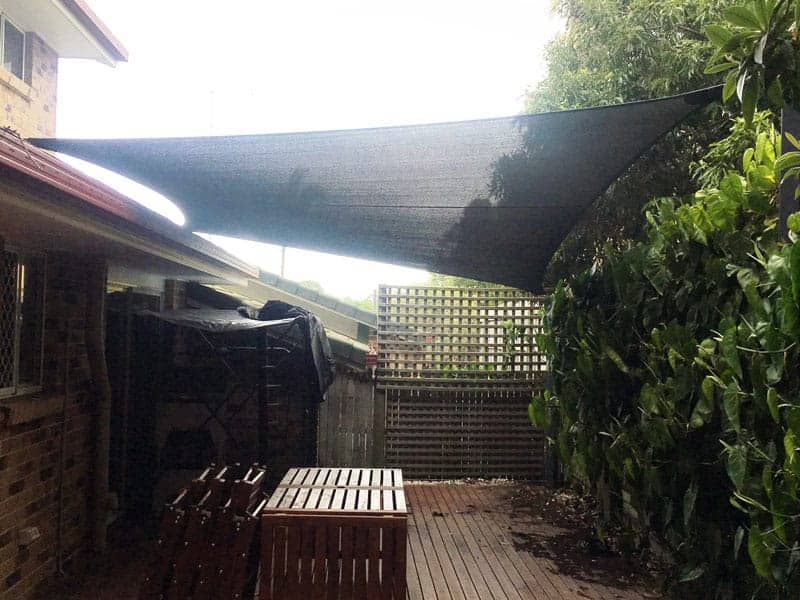 Norman-Park-Brisbane-Shade-Sail-over-deck,-disappearing-into-wall-garden