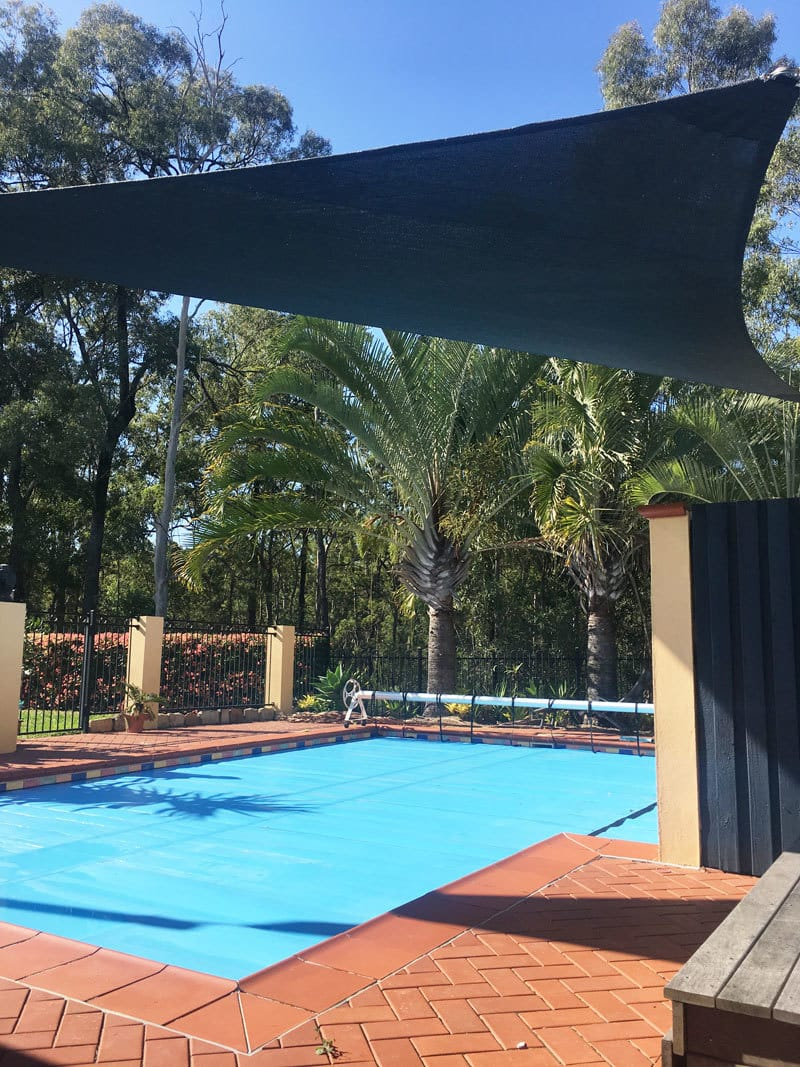 Pool Shade Sail installed at Albany Creek, Brisbane in Abshade charcoal material.