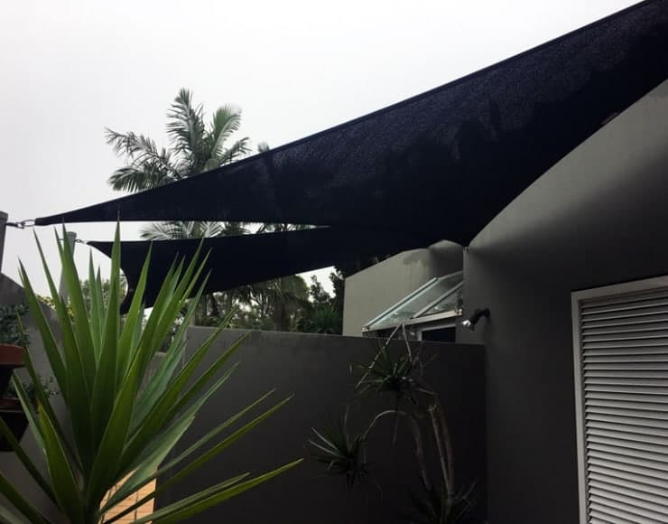 Privacy shade sails installed in Springwood, Brisbane by Superior Shade Sails.