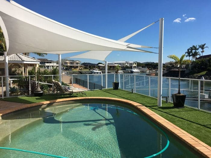 Shade sail installation at Newport, Brisbane. Canal lifestyle sails in Rainbow Shade - Ice white Z-16 fabric.