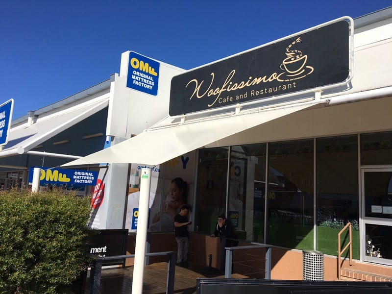 Shade sail installation at Woofissimo Cafe, Macgregor