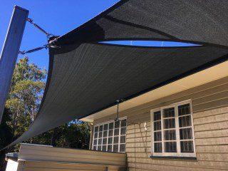 Installation of carport shade sails in charcoal at Tivoli by Superior Shade Sails
