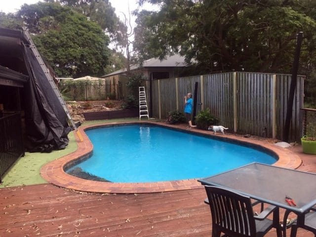 Pool shade sail installation at Barellan - 6 point sail with sail track for pool and leaf cover by Superior Shade Sails, Brisbane