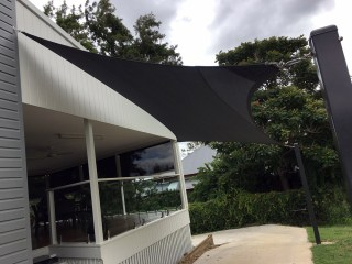 Installation of a 4 point carport shade sail in charcoal at Ipswich