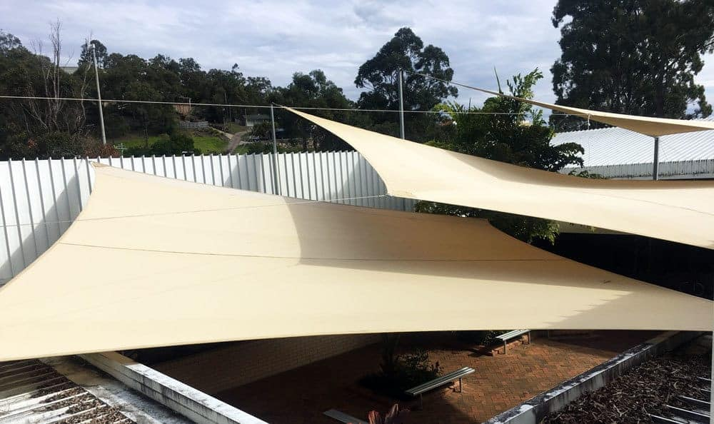 Ultrablock tri-layered shade sail in outdoor space of the church at Mount Warren Par