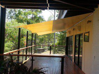 Sun shade sail over verandah