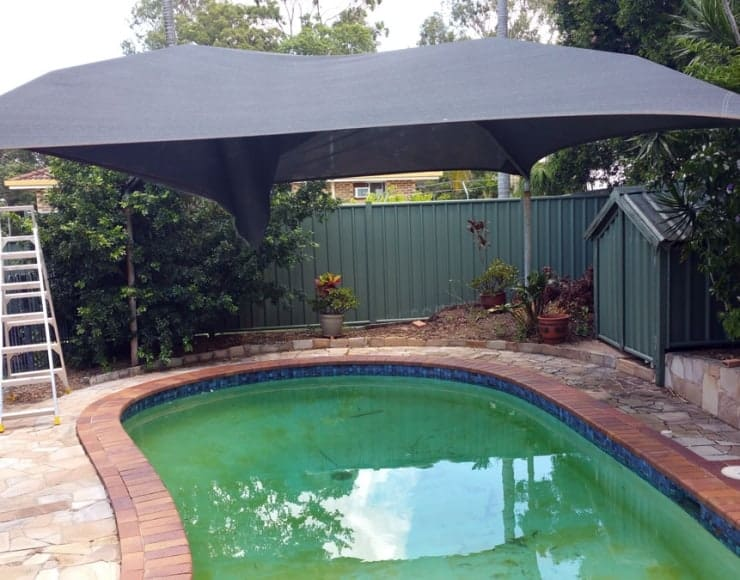 Keep cool under the Sail Shade in your swimming pool - Superior Shade Sails