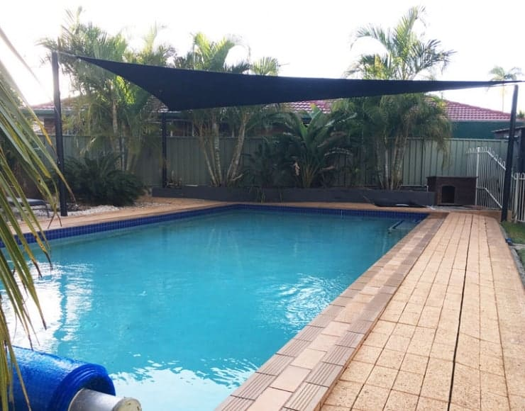 Pool sun shade in black Extrablock material in 330gsm by Superior Shade Sails