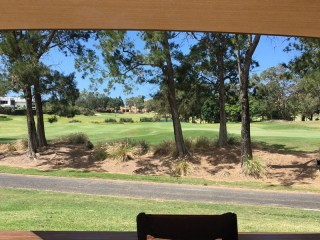 Gold Coast shade sail on sail track with golf course outlook