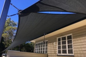 Installation of carport shade sails in charcoal at Tivoli by Superior Shade Sails
