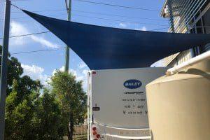CARAVAN SHADE SAIL installed at Redbank to protect the Bailey Caravan by Superior Shade Sails.