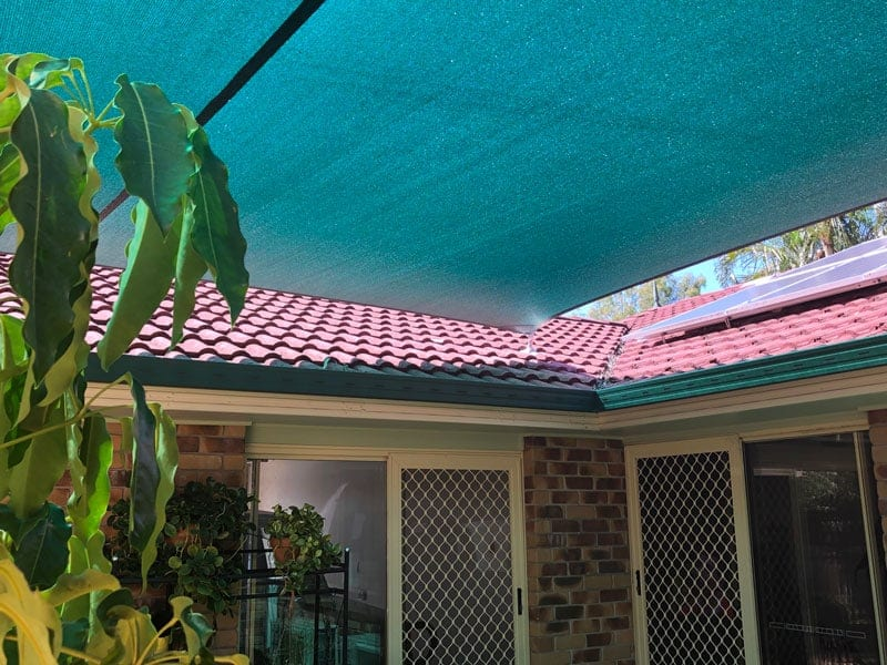 4 point shade sail installed at Forest Lake in Rainforest Green