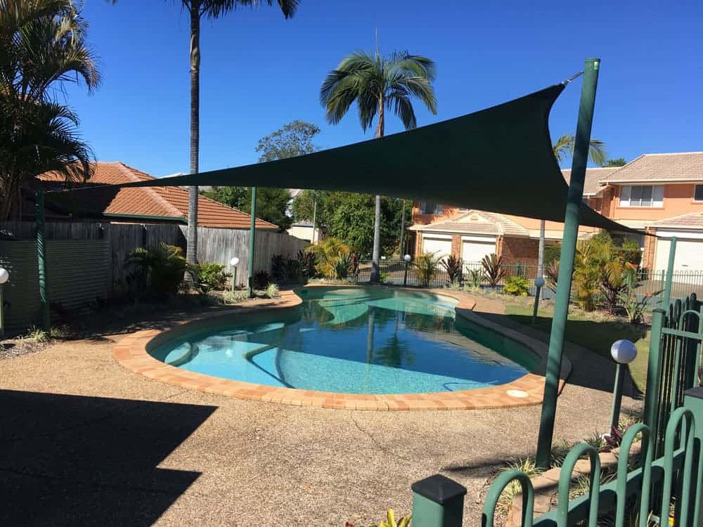 Pool shade sails installed at Springfield in 330gsm Extrablock Material by Superior Shade Sails.