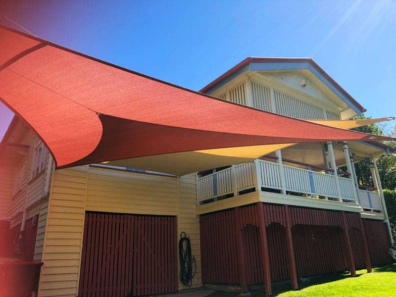 Twin Carport Overlapping Shade Sails for this Queenslander home in Morningside, Brisbane south using the Z-16 Rainbow Shade.