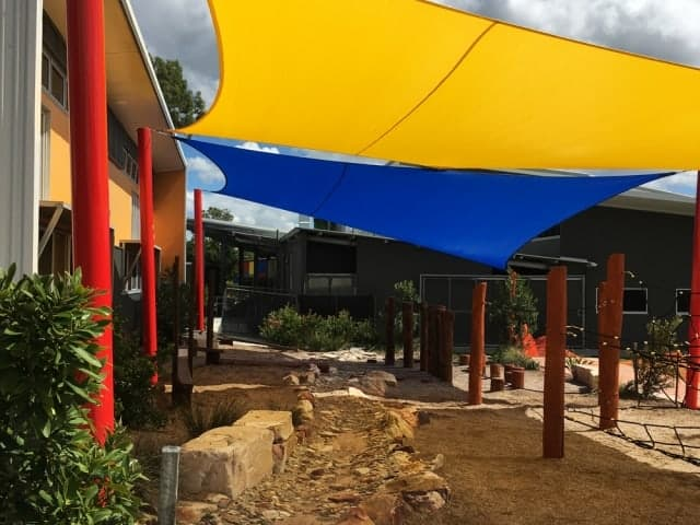 Colourful shade sail installation at St Stephens School, Algester by Superior Shade Sails.