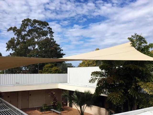 Ultrablock tri-layered shade sail in outdoor space of the church at Mount Warren Park.
