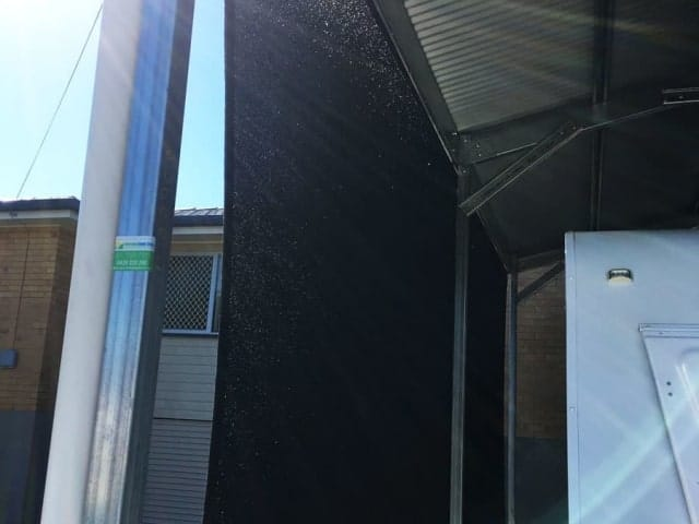 Goodna-Carport sun sail in black Abshade material - 316 marine grade wire and rigging - creating vertical block out screens.