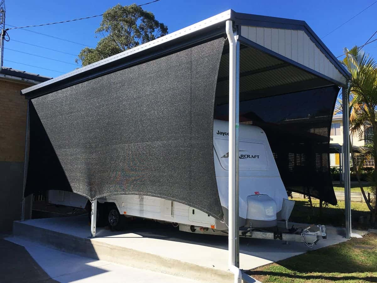 Goodna - carport sun sail - in black abshade material - 316 marine grade wire and rigging - creating vertical block out screens.