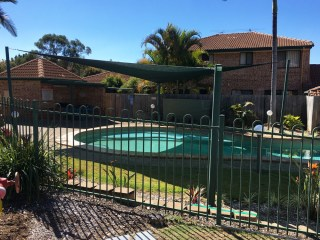 Pool shade sail in 330gsm extrablock material - Springfield installed by Superior Shade Sails