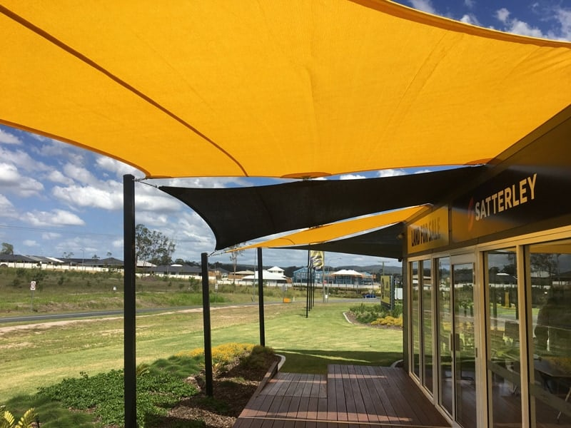 Ipswich/Ripley, Binnies Road - Land sales office - installation of commercial sails for street appeal and much needed sun protection by Superior Shade Sails.