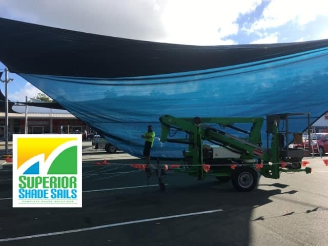 New Shade Sail for Marsden Park Shopping Center. We installed one 65 edge meter Hyper Shade Sail and attached to existing points and sails.
