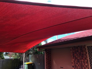 Replacement 5 point Carport shade sail in Brisbane Marsden in the new Rainbow shade Z-16 colour of Red Earth installed by Superior Shade Sails.