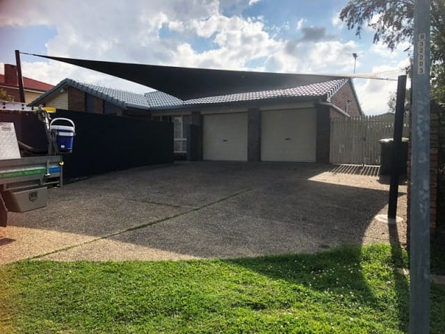 5 Point Carport Shade Sail installed at Carindale in Z-16 material. We set up black powder coated posts and embedded into the concrete driveway with 20mm 316 marine grade stainless steel brackets and marine grade thread.