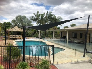 Another Happy Customer - Installed at Forestdale, Brisbane a Pool Shade Sail in a tropical resort style setting with a 1 x 4 point Z-16 sail.