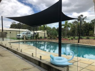 Installed at Forestdale, Brisbane a Pool Shade Sail in a tropical resort style setting with a 1 x 4 point Z-16 sail.