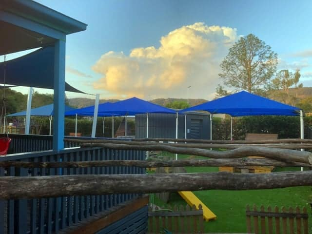 Replacement Shade Sail for Childcare Centre, Dayboro, installed by Superior Shade Sails using a 4 hip and ridge framed shade sail in z-16 fabric.