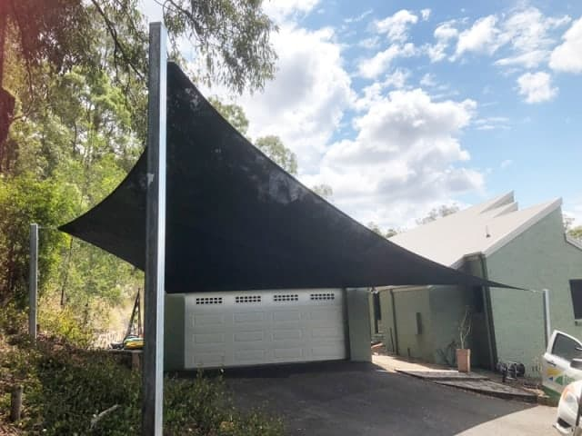 Carport Shade Sail installed at Pullenvale, Brisbane on a very steep block installed by Superior Shade Sails, Brisbane
