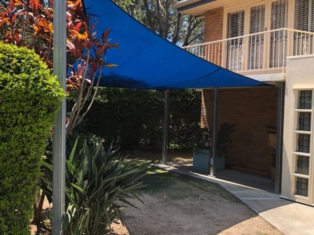 4 point shade sail installed at Aspley, Brisbane using Z-16 Blue Fabric and galvanised steel posts.
