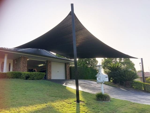 The biggest 5 point Sun Shade Sail in Parkinson made from Protex Parasol in Black with Black posts providing expansive coverage.