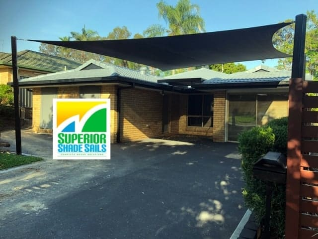 Carport Shade Sail for sun shade installed in Forest Lake south of Brisbane in Black Z-16 material with Black powder coated posts.