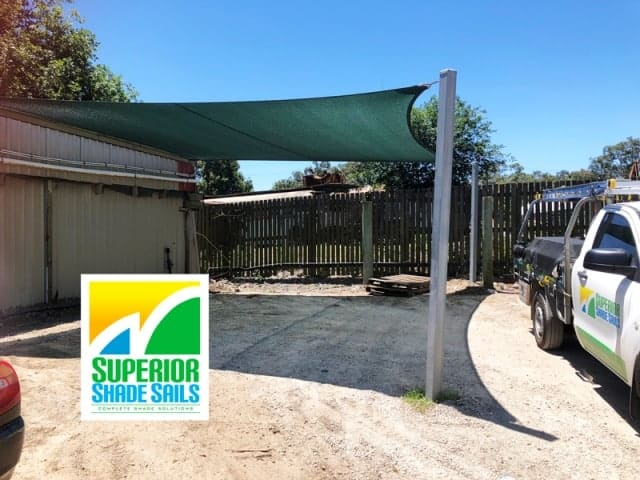 Replacement Shade Sail for Centenary Landscape Supplies using a 4 point Abshade Sail installed to protect the Turf.
