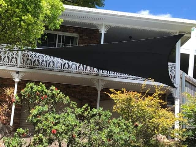 New 5 point shade sail in Chapel Hill in the much loved Hyper shape using Z-16 Charcoal shade cloth fabric with 2 galvanized steel posts coated in white.