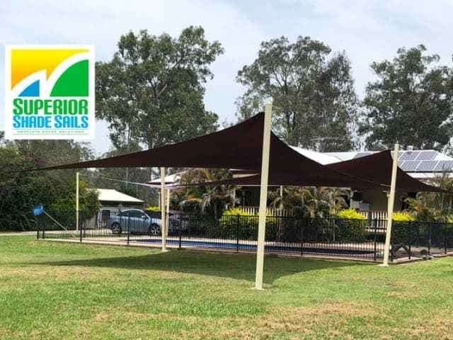 Installed two 5 Point Hyper Shade Sails in Jimboomba. Both sun shade sails in Extrablock Sunblaze with powdercoated steel posts.