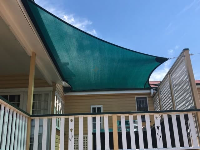 Patio Shade Sail -To keep the family BBQ out of the sun for this Queenslander in Nundah, Brisbane.We used the Rainbow Z-16 sail fabric in the colour Rainforest and 316 marine grade trace wire with two roof brackets attached.