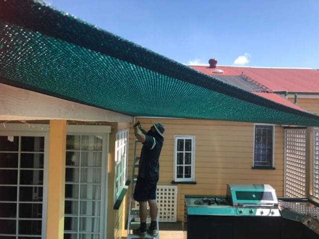 Patio Shade Sail - To keep the family BBQ out of the sun for this Queenslander in Nundah, Brisbane.We used the Rainbow Z-16 sail fabric in the colour Rainforest and 316 marine grade trace wire with two roof brackets attached.