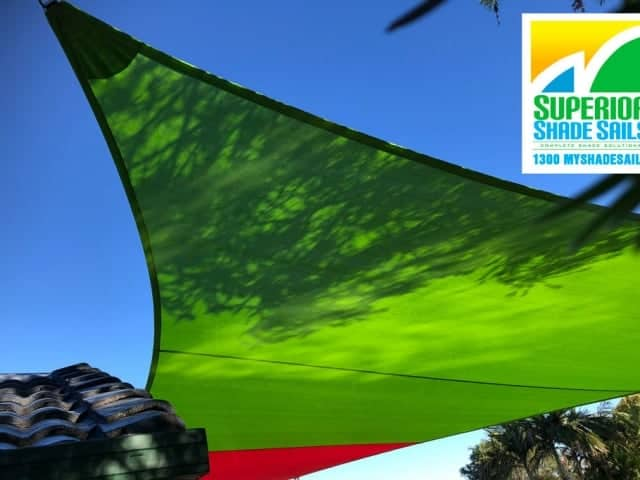Driveway Shade Sail in Zesty Lime/Red combo using Extreme 32 material installed at Runcorn, Brisbane.