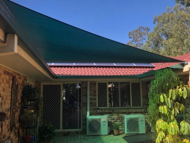 4 Point shade sail in Rainforest Green in Forest Lake.