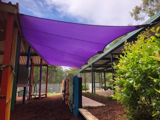 Playground Shade Sail in Purple for this State School. Created in Z-16 material as an island shade sail to protect children for years to come from harmful sun rays.