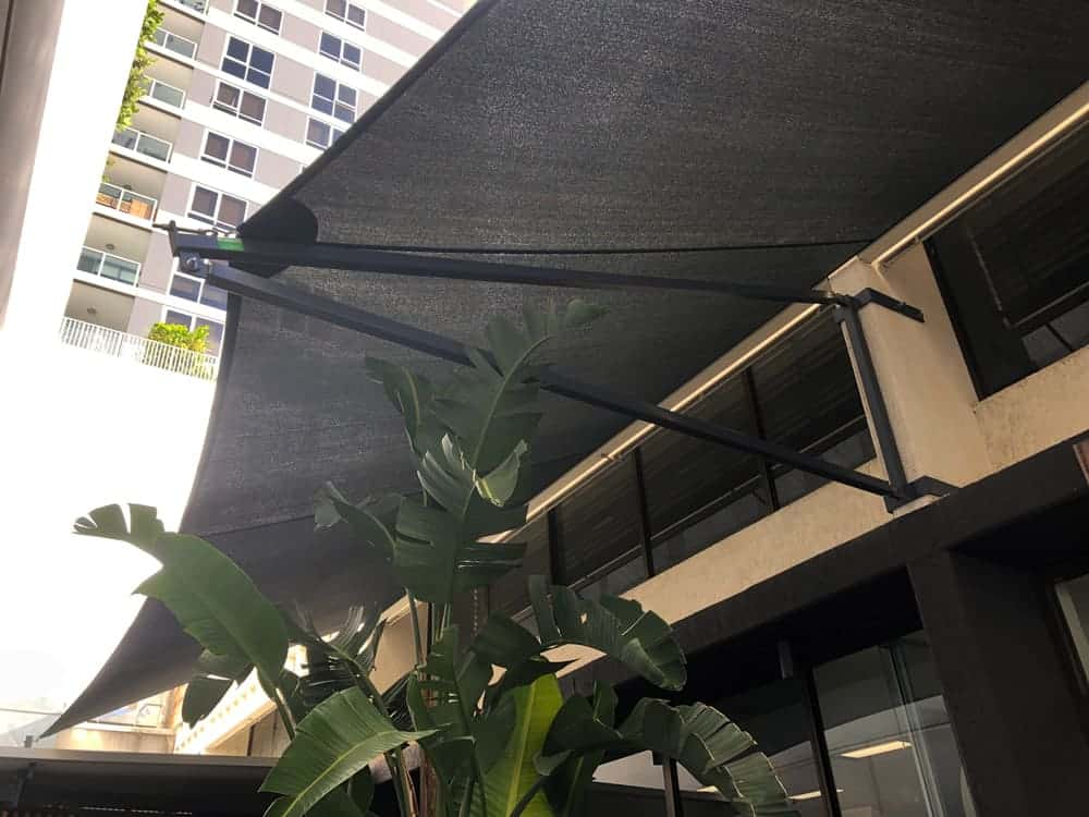 Awning Shade Sail on a Sail Track which is not only aesthetically pleasing, but will reduce the heat on the windows for this South Brisbane business by Superior Shade Sails, Brisbane