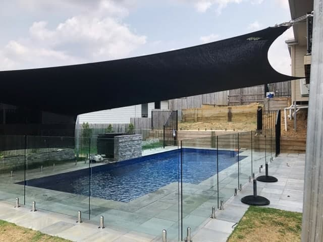 Pool shade sail set up as a 6 point shade sail with a vertical screen by Superior Shade Sails in Springfield Lakes.