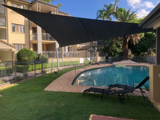Pool Shade Sail installed at UQ Manor Apartments by Superior Shade Sails.