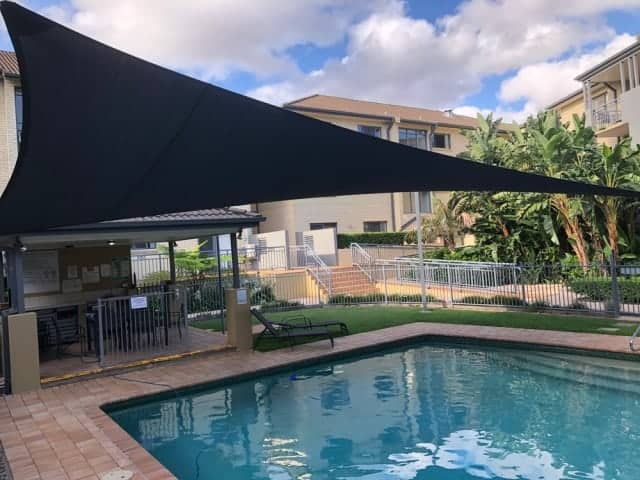Pool Shade Sail installed at UQ Manor Apartments by Superior Shade Sails.