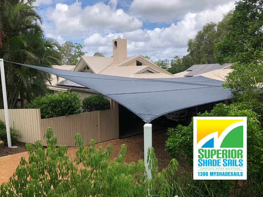 6 point Carport Shade Sail with white powder coated posts for this lovely home in Indooroopilly. Superior Shade Sails offers a complete design & installation service and a variety of colours to choose from.