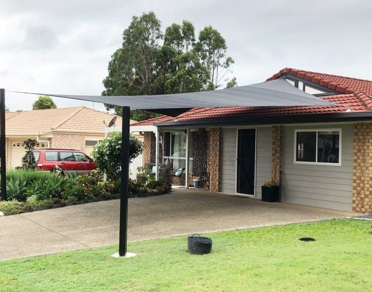 Simply just add a Shade Sail over your driveway for the vehicles and convert the garage into more living space.